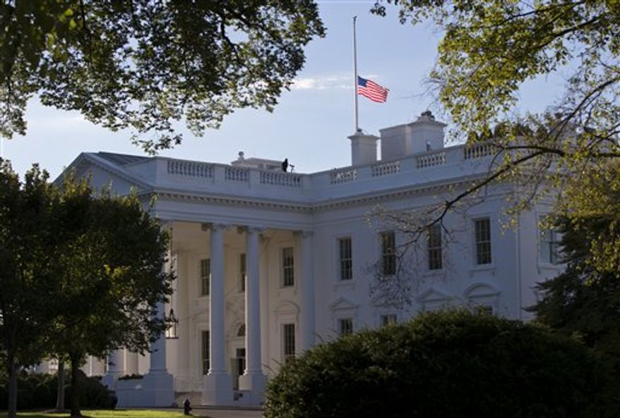 ** FILE ** The American flag flies at half-staff over the White House on Sept. 15, 2012, in honor of those who died when an angry mob stormed the U.S. Consulate in Libya's eastern city of Benghazi on Sept. 11, 2012. The U.S. Ambassador to Libya, Christopher Stevens, was killed along with three other Americans. (AP Photo/J. Scott Applewhite)