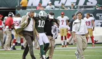 New York Jets wide receiver Santonio Holmes (10) is helped off the field after being injured during the second half of an NFL football game against the San Francisco 49ers Sunday, Sept. 30, 2012, in East Rutherford, N.J. (AP Photo/Bill Kostroun)