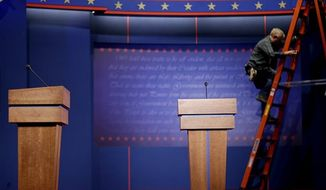 The stage is seen before a presidential debate at the University of Denver Tuesday, Oct. 2, 2012, in Denver. President Barack Obama and Republican presidential candidate and former Massachusetts Gov. Mitt Romney will hold their first debate Wednesday. (AP Photo/David Goldman)
