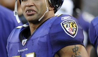 In this Dec. 24, 2011 photo, Baltimore Ravens linebacker Brendon Ayanbadejo looks on from the sideline in the second half of an NFL football game against the Cleveland Browns in Baltimore. Minnesota Vikings punter Chris Kluwe has argued against a constitutional amendment to ban gay marriage in Minnesota. Kluwe also defended Baltimore linebacker Brendon Ayanbadejo after he was criticized by a Maryland politician for publicly supporting gay marriage. (AP Photo/Nick Wass)