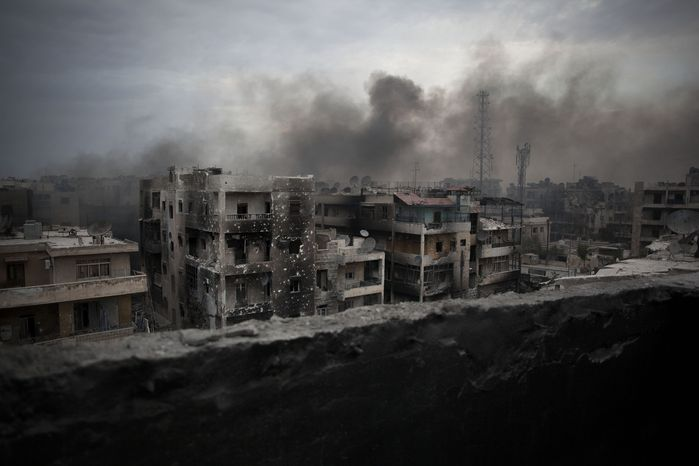 Smoke rises over the Saif Al Dawla district in Aleppo, Syria, on Tuesday, Oct. 2, 2012. (AP Photo/Manu Brabo)