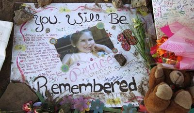 A poster in memory of Veronica Moser-Sullivan, 6, is shown July 27, 2012, at the memorial to victims of the Aurora, Colo., movie theater shooting. (Associated Press)