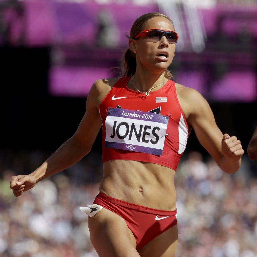 FILE - This Aug. 6, 2012 file photo shows hurdler Lolo Jones competing in a women's 100-meter hurdles heat at at the 2012 Summer Olympics in London. Jones trash-talked about head injuries to former Rutgers football player Eric LeGrand, Tuesday, Oct. 2, 2012,  after he jokingly challenged her to a race on Twitter. Jones didn't know the defensive tackle was paralyzed in a game. (AP Photo/Anja Niedringhaus, File)
