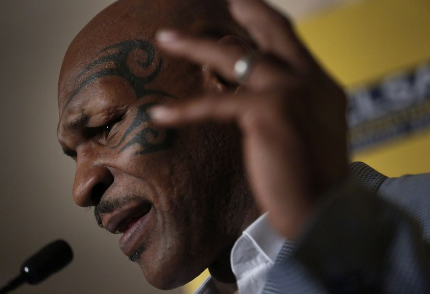 Former heavyweight boxing champion Mike Tyson speaks a press conference at the 19th Credit Lyonnais Securities Asia (CLSA) Investors Forum in Hong Kong on Wednesday, Sept. 12, 2012. (AP Photo/Vincent Yu)