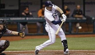 Tampa Bay Rays' Evan Longoria swings on a sixth-inning home run off Baltimore Orioles pitcher Jake Arrieta during a baseball game Wednesday, Oct. 3, 2012, in St. Petersburg, Fla. The hit was Longoria's third home run of the game. Tampa Bay won 4-1. (AP Photo/Chris O'Meara)