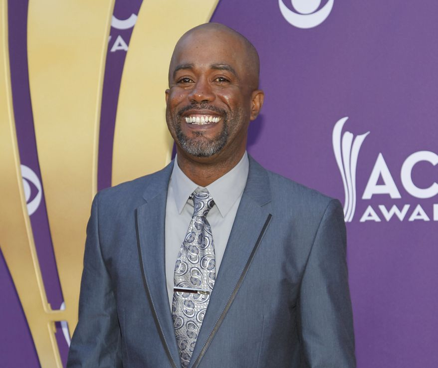 Darius Rucker arrives at the 47th annual Academy of Country Music Awards in Las Vegas on Sunday, April 1, 2012. (AP Photo/Isaac Brekken)