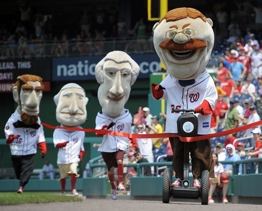 """This photo taken June 1, 2012 shows Teddy Roosevelt , left, crossing the finish line riding a Segway, defeating the other Presidents in the """"Presidents Race"""" held between innings at the Washington Nationals baseball game at Nationals Park in Washington. (AP Photo/John McDonnell, The Washington Post)WIRES OUT MAGS OUT TV OUT NEW YORK TIMES WASHINGTON TIMES OUT NO TRADES NO SALES MANDATORY CREDIT"""