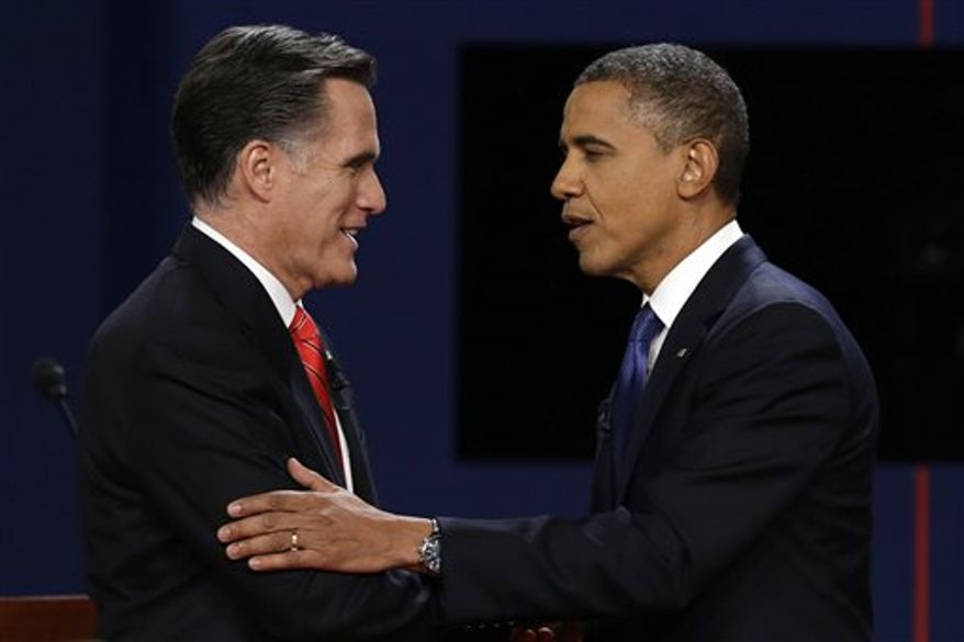 Republican presidential nominee Mitt Romney and President Barack Obama shake hands after the first presidential debate at the University of Denver, Wednesday, Oct. 3, 2012, in Denver. (AP Photo/Charlie Neibergall)