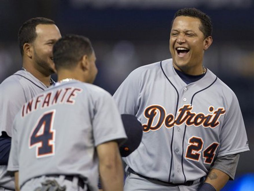 Detroit Tigers' Miguel Cabrera (24) talks with teammates, including Omar Infante (4), before the Tigers' baseball game against the Kansas City Royals at Kauffman Stadium in Kansas City, Mo., Wednesday, Oct. 3, 2012. (AP Photo/Orlin Wagner)