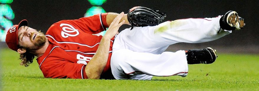 MAY 6: Nationals right fielder Jayson Werth grimaced after breaking his left wrist in a Sunday night loss to Philadelphia. Werth would be sidelined for three months. The game also featured Phillies left-hander Cole Hamels intentionally hitting rookie Bryce Harper, and Harper subsequently stealing home. (Associated Press)