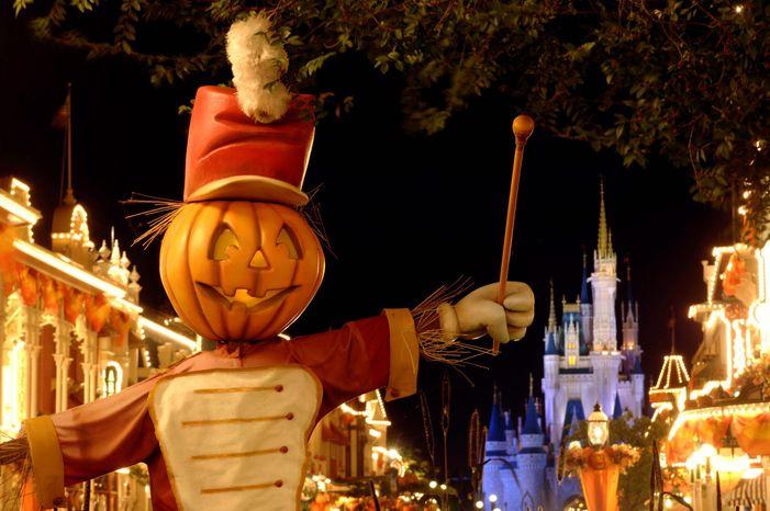 A Jack-O-Lantern bandleader appears on Main Street, U.S.A., in Walt Disney World's Magic Kingdom in Lake Buena Vista, Fla. (AP Photo/Disney, Kent Phillips)
