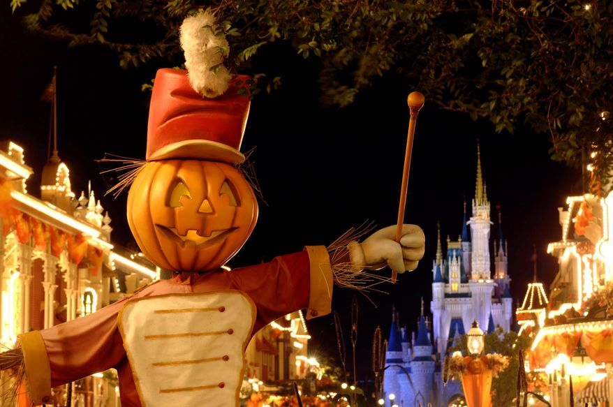 A Jack-O-Lantern bandleader appears on Main Street, U.S.A., in Walt Disney World's Magic Kingdom in Lake Buena Vista, Fla. (AP Photo/Disney, Kent Phillips)