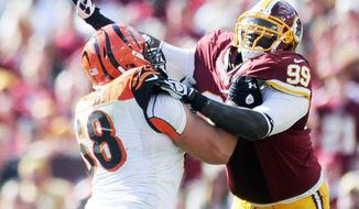 Washington Redskins defensive tackle Jarvis Jenkins (99) rushes the quarterback against Cincinnati Bengals guard Kevin Zeitler (68) at FedEx Field, Landover, Md., Sep. 23, 2012. (Preston Keres/Special to The Washington Times)
