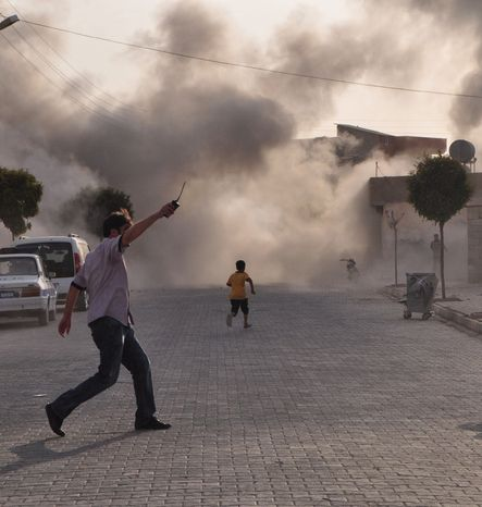 A shelling attack Wednesday in Akcakale, Turkey, escalated cross-border tensions with Syria. A woman, her three daughters and another woman were killed and 10 others were wounded. (Associated Press)
