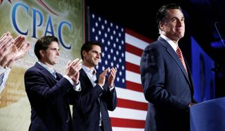GOP presidential hopeful Mitt Romney is applauded by sons Josh (center) and Tagg (left) as he speaks Thursday at a Conservative Political Action Conference in Denver. Attendees hailed his debate performance of the night before.  (Associated Press)