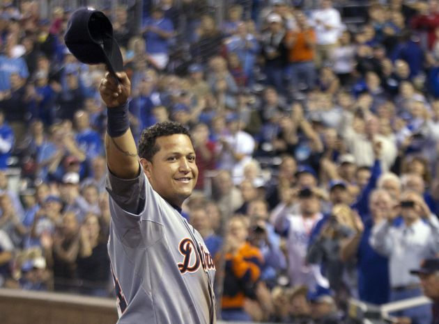 Detroit Tigers' Miguel Cabrera waves to the crowd after being replaced during the fourth inning of a baseball game against the Kansas City Royals at Kauffman Stadium in Kansas City, Mo., Wednesday, Oct. 3, 2012. Cabrera achieved baseball's first Triple Crown since 1967 by leading the league with a .330 average, 44 home runs and 139 RBIs in the regular season. (AP Photo/Orlin Wagner)
