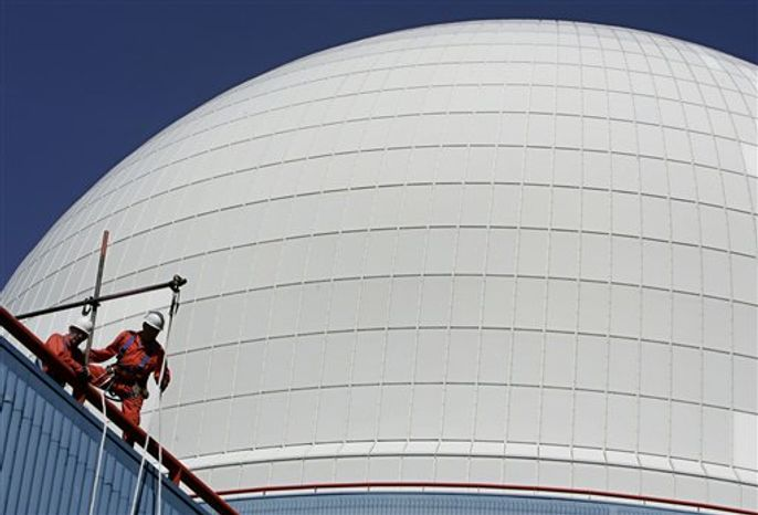 ** FILE ** Backdropped by the dome of the nuclear reactor of the Sizewell nuclear plant, commissioned in 1995, workers perform their duties in eastern England in this Monday, June 5, 2006, photo. EU Energy Commissioner Guenther Oettinger says the cost of necessary improvements at the 145 nuclear reactors in the 27-nation European Union could be as high as 25 billion euros ($32 billion) over the coming years. (AP Photo/Lefteris Pitarakis)