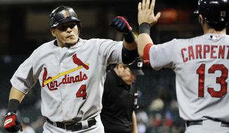 St. Louis Cardinals' Yadier Molina (4) is congratulated by Matt Carpenter (13) on a solo home run against the Houston Astros in the fourth inning of a baseball game, Monday, Sept. 24, 2012, in Houston. (AP Photo/Pat Sullivan)