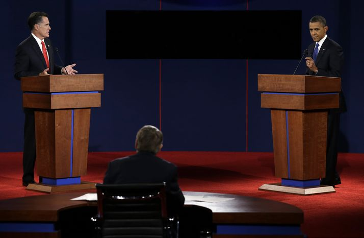 Republican presidential candidate Mitt Romney (left) and President Obama participate in the first presidential debate at the University of Denver in Denver on Wednesday, Oct. 3, 2012. (AP Photo/Charlie Neibergall)