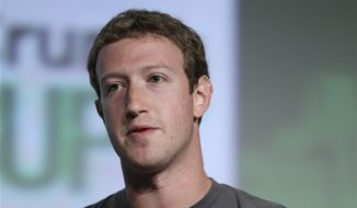 "** FILE ** Facebook CEO Mark Zuckerberg speaks during a ""fireside chat"" at a conference organized by technology blog TechCrunch in San Francisco on Tuesday, Sept. 11, 2012. (AP Photo/Eric Risberg)"