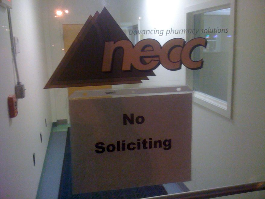 A sign on the door to the New England Compounding Center requests no soliciting at the Framingham, Mass., company on Oct. 3, 2012. An outbreak of a rare and deadly form of meningitis sickened 26 people in five states who received steroid injections mostly for back pain, health officials said. The Food and Drug Administration identified the New England company as the maker of the steroid. (Associated Press)