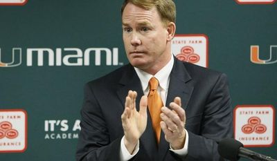 FILE - This April 19, 2011 file photo shows Miami athletic director Shawn Eichorst clapping as he speaks during a news conference in Coral Gables, Fla. A person with knowledge of the situation says that Eichorst has resigned, less than 18 months after he began leading the Hurricanes' troubled department. The person spoke to The Associated Press Thursday, Oct. 4, 2012,  on condition of anonymity because the university had not publicly announced Eichorst's decision, and that university officials were deciding on how to proceed with an interim AD.  (AP Photo/Wilfredo Lee, File)