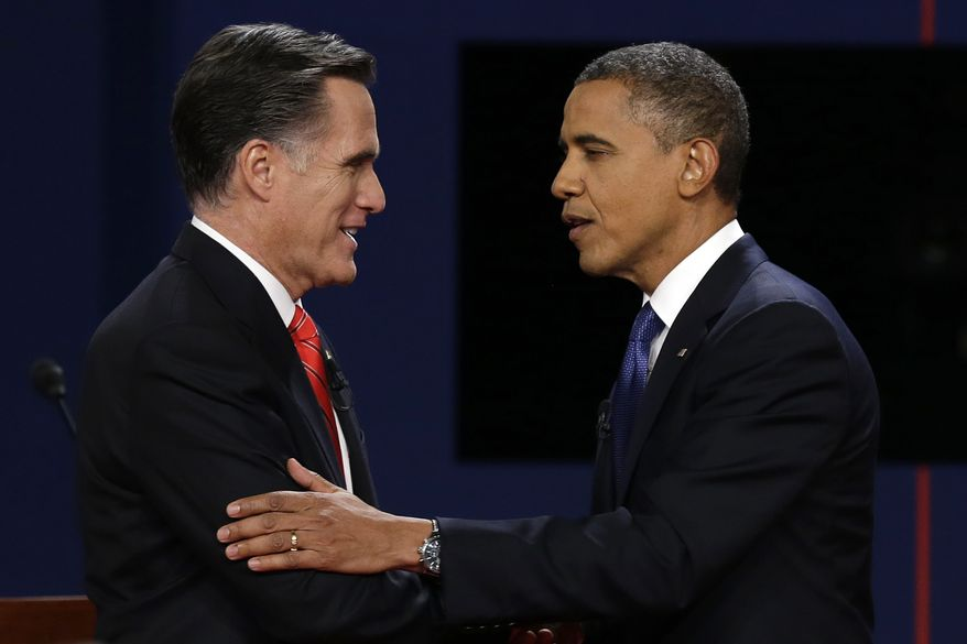 Republican presidential nominee Mitt Romney and President Obama shake hands on Wednesday, Oct. 3, 2012, after the first presidential debate at the University of Denver. (Associated Press)