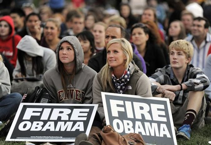Jordan Johnston, 20, and Jessica Johnston, 27, supporters of Republican presidential candidate Mitt Romney prepare to watch the debate on a outside screen at the University of Denver Wednesday, Oct. 3, 2012, in Denver. (AP Photo/Chris Schneider)