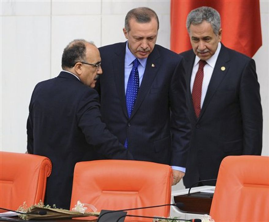 ** FILE ** In this Monday, Oct. 1, 2012, photo, Prime Minister Recep Tayyip Erdogan, center, and his deputies Bulent Arinc, right, and Besir Atalay seen at Turkey's parliament in Ankara, Turkey. (AP Photo)