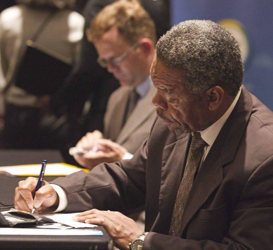 Donald Smith, of Atlanta, fills out an application Oct. 3, 2012, at the National Job Fair in Atlanta. (Associated Press)