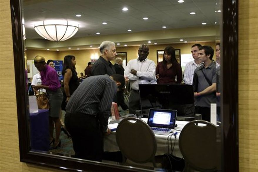 ** FILE ** In this Monday, Sept 17, 2012, file photo, Robert Orkin, of the company TxT-Alert, third from left, talks with job seekers during a job fair held by National Career Fairs, in Fort Lauderdale, Fla. Economists forecast that the unemployment rate edged up in September to 8.2 percent from 8.1 percent, according to a survey by FactSet. Employers are expected to have added 111,000 jobs. (AP Photo/Lynne Sladky, File)