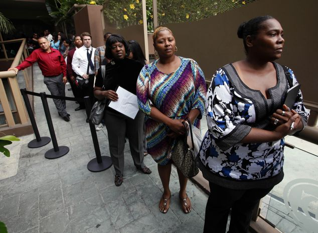 **FILE** Sheila Bird (right) waits in line for employment interviews at a job fair at City Target in Los Angeles on Aug. 17, 2012. (Associated Press)