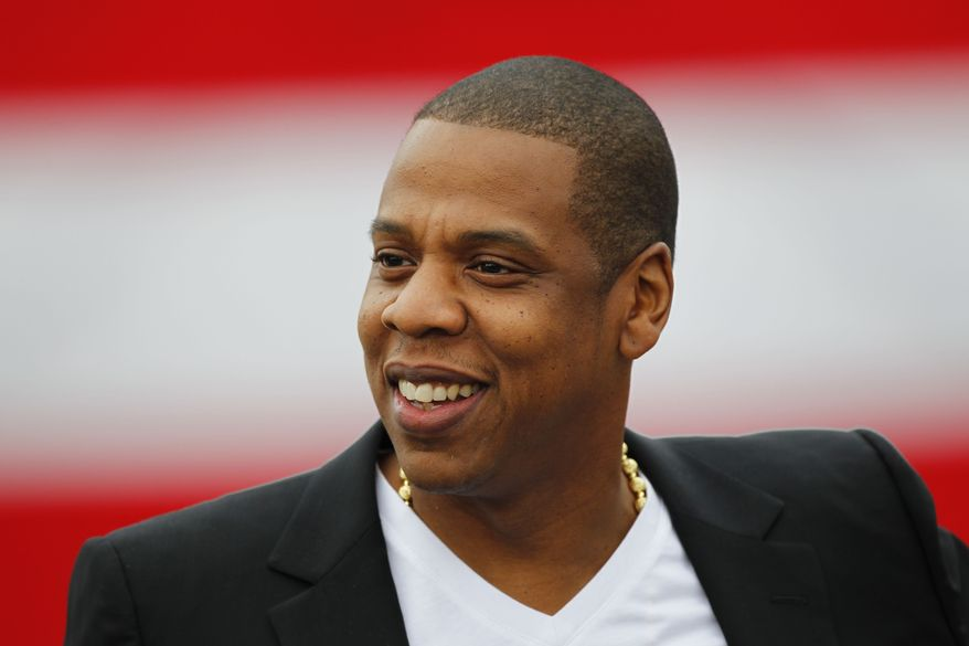 "Recording artist Shawn ""Jay-Z"" Carter smiles during a May 14, 2012, news conference at the Philadelphia Museum of Art in Philadelphia. (Associated Press) **FILE**"