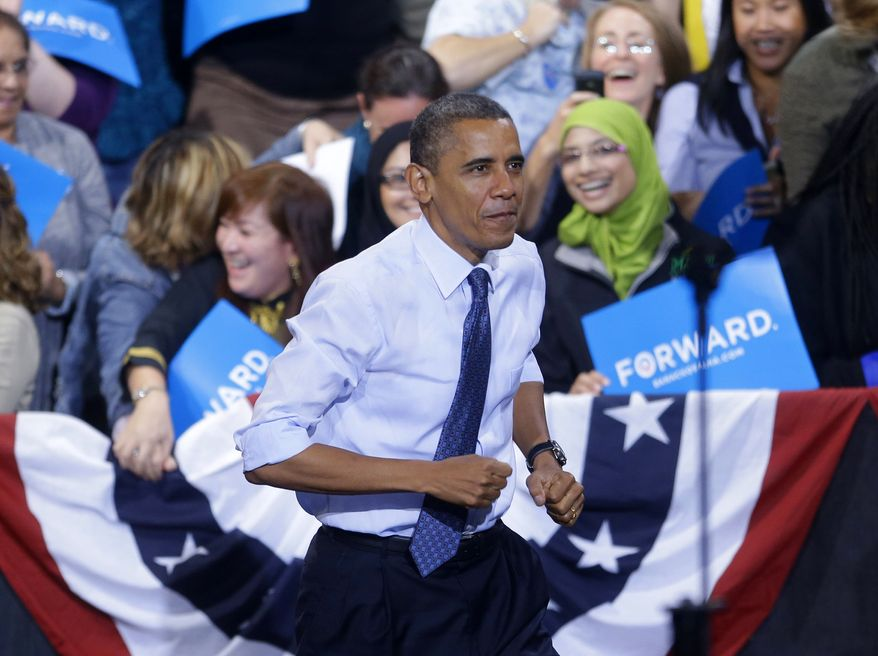 President Obama takes the stage on Friday, Oct. 5, 2012, during a campaign event at George Mason University in Fairfax, Va. (Associated Press)