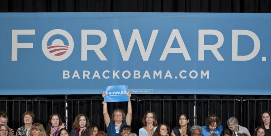 Woman supporters provide the backdrop for President Obama's campaign event Friday, Oct. 5, 2012, at George Mason University in Fairfax, Va. (Craig Bisacre/The Washington Times)