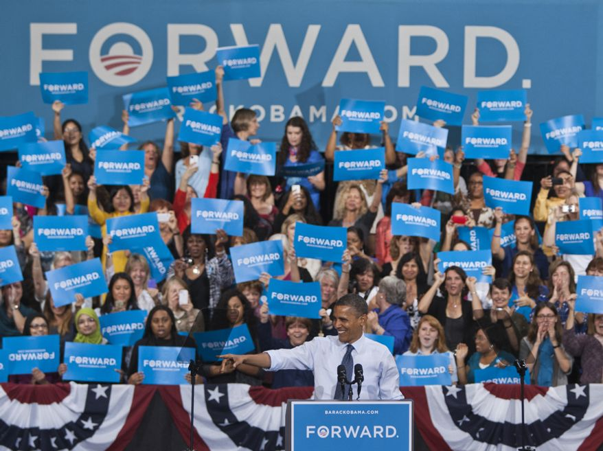 President Obama points and waves to supporters during a campaign event Friday, Oct. 5, 2012, at George Mason University in Fairfax, Va. (Craig Bisacre/The Washington Times)