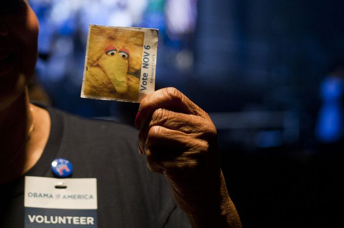 Supporters wear Big Bird pins from Sesame Street during President Obama's campaign event Friday, Oct. 5, 2012, at George Mason University in Fairfax, Va. The use of Big Bird pins comes days after Republican presidential candidate Mitt Romney referenced to the Sesame Street character during the debate this past Wednesday. (Craig Bisacre/The Washington Times)