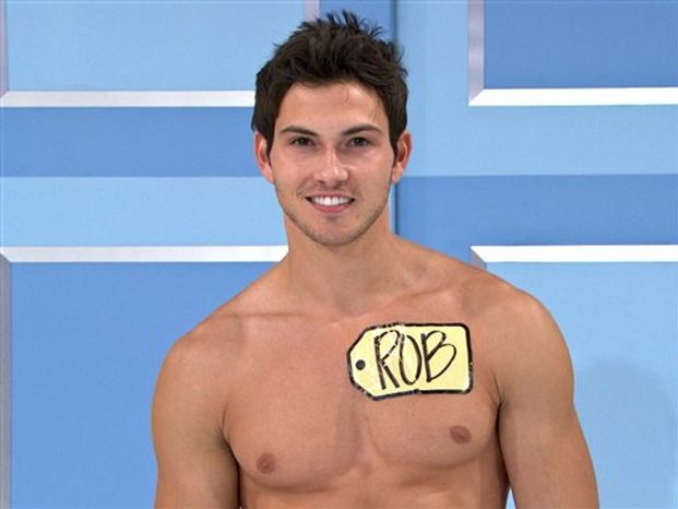 """This undated image from video shows Rob Wilson, of Boston, who was chosen in an online competition to be the first male model on the popular daytime game show, """"The Price is Right."""" Wilson begins his weeklong stint alongside the ladies on Oct. 15. (AP Photo/CBS)"""
