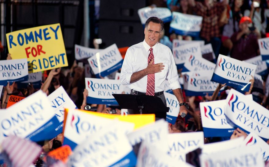 Republican presidential candidate Mitt Romney greets supporters Oct. 4, 2012, as he takes the stage during a rally at the Augusta Expoland in Fishersville with running mate Paul Ryan. (Associated Press/Michael Reilly, Daily News-Record)