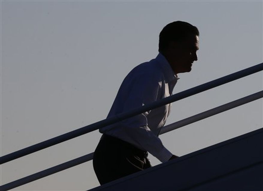 Republican presidential candidate and former Massachusetts Gov. Mitt Romney boards his campaign plane at Weyers Cave-Shenandoah Valley Airport in Weyers Cave, Va., Friday, Oct. 5, 2012. (AP Photo/Charles Dharapak)