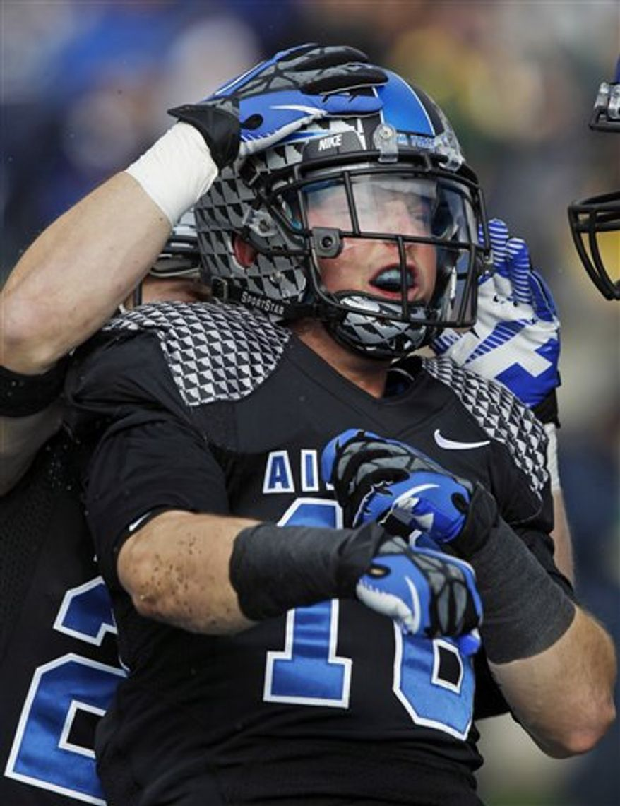 Air Force wide receiver Drew Coleman celebrates his touchdown catch against Navy during the first quarter of an NCAA college football game at Air Force Academy, Colo., on Saturday, Oct. 6, 2012. (AP Photo/David Zalubowski)