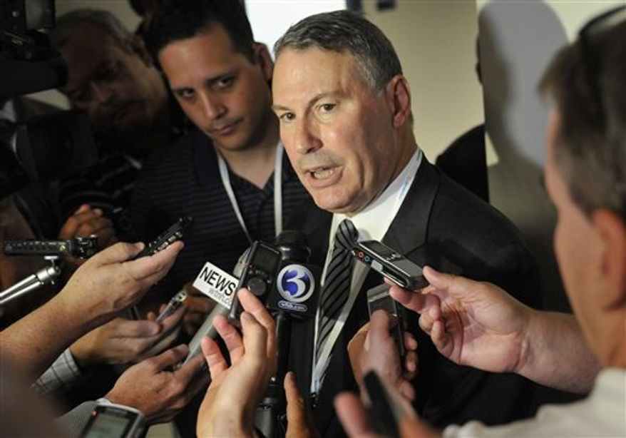 ** FILE ** This Aug. 30, 2012, file photo shows Big East commissioner Mike Aresco answering questions from the media before an NCAA college football game between Connecticut and Massachusetts at Rentschler Field in East Hartford, Conn. (AP Photo/Jessica Hill, File)