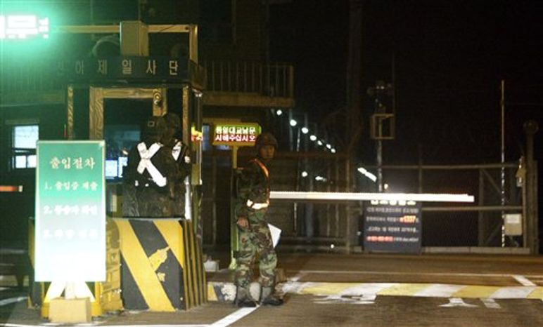 South Korean soldiers stand guard at a traffic control gate near the truce village of Panmunjom, in the demilitarized zone that separates the two Koreas, in Paju, north of Seoul, South Korea, Saturday, Oct. 6, 2012. A North Korean soldier killed two of his superiors Saturday and defected to South Korea across the countries' heavily armed border in a rare crossing that prompted South Korean troops to immediately beef up their border patrol, officials said. (AP Photo/Bae Jung-hyun, Yonhap)