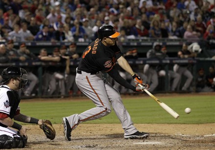 Texas Rangers catcher Mike Napoli (25) watches as Baltimore Orioles' Manny Machado (13) connects for a run scoring single off of Rangers closer Joe Nathan in the ninth inning American League wild-card playoff baseball game Friday, Oct. 5, 2012, in Arlington, Texas. The shot scored Lew Ford. (AP Photo/Tony Gutierrez)