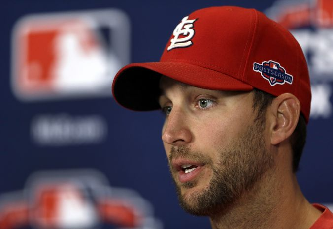 St. Louis Cardinals pitcher Adam Wainwright speaks during a news conference, Saturday, Oct. 6, 2012, in St. Louis. Wainwright is scheduled to start for the Cardinals in Game 1 of the National League division series against the Washington Nationals on Sunday. (AP Photo/Jeff Roberson)