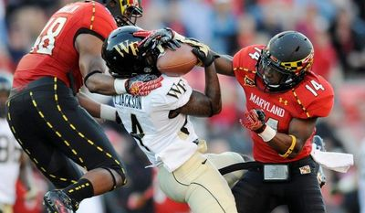 Maryland defensive backs Eric Franklin (left) and Jeremiah Johnson break up a pass intended for Wake Forest wide receiver Lovell Jackson during Saturday's victory at College Park. (Associated Press)