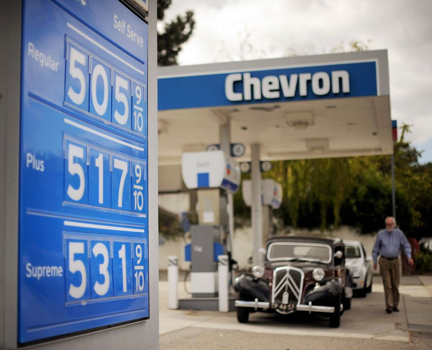 Gasoline prices higher than $5 per gallon are posted at a Menlo Park, Calif., Chevron station on Friday. In California, gasoline prices jumped overnight by as much as 20 cents a gallon, ending a week of soaring costs that saw some stations close. (Associated Press)