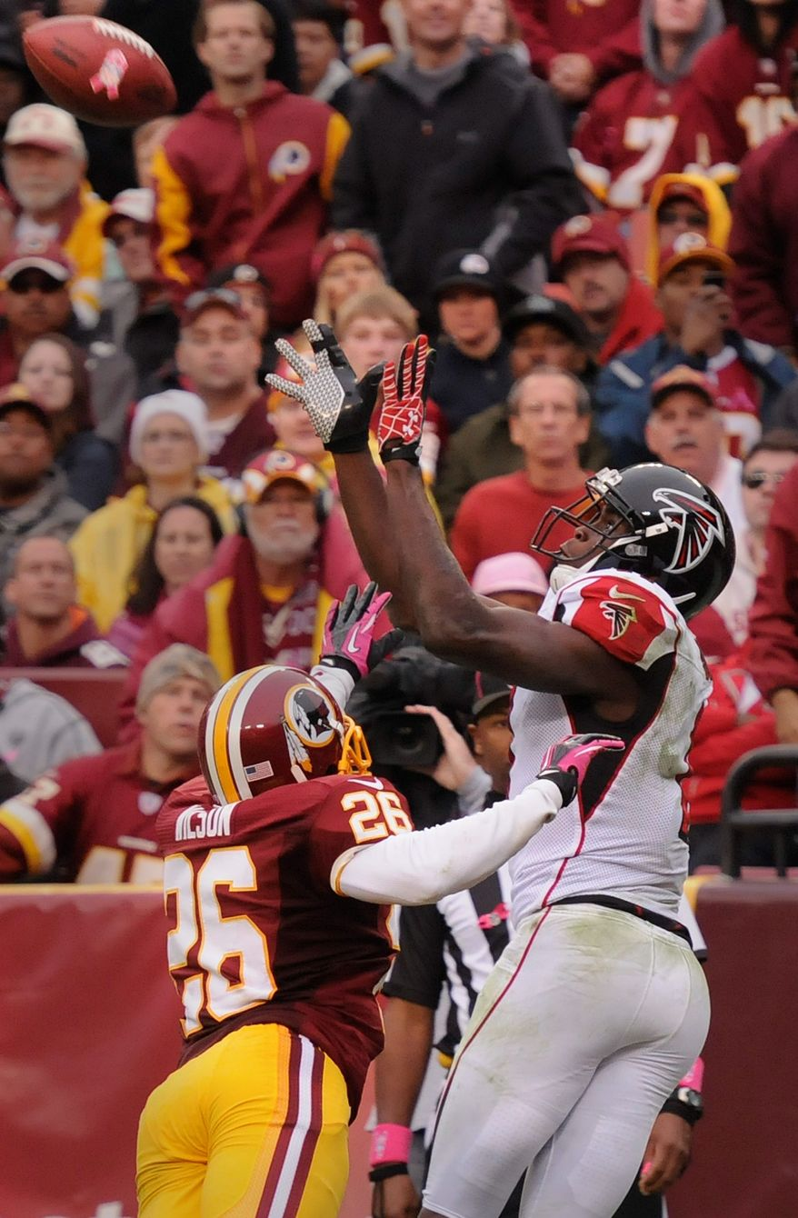 Falcons wide receiver Julio Jones (11) hauls in an 18-yard touchdown pass over Washington Redskins cornerback Josh Wilson (26) in the fourth quarter at FedEx Field, Landover, Md., Oct. 10, 2012. (Preston Keres/Special to The Washington Times)