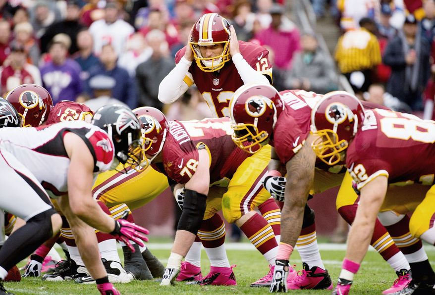 Rookie Kirk Cousins took over after Robert Griffin III suffered a concussion. Cousins was 5 of 9 for 111 yards with a 77-yard touchdown and two interceptions. (Andrew Harnik/The Washington Times)