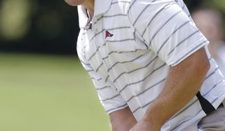 David Lingmerth, of Sweden, reacts to his putt on the 13th green against playing partner Ben Martin during the quarterfinal round of the U.S. Amateur Golf Championship in Tulsa, Okla., Friday, Aug. 28, 2009. (AP Photo)